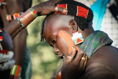 Boys wear makeup for the bull jumping ceremony, Ethiopia Stock Photo