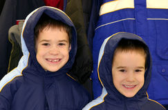 Boys Wearing Coats. Two Boys dressed in matching winter coats royalty free stock image