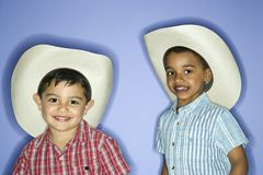 Boys wearing cowboy hats. Stock Photo