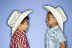 Boys wearing cowboy hats. Stock Image