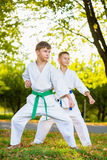 Boys in white kimono during training karate Royalty Free Stock Images