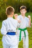 Boys in white kimono during training karate Stock Image