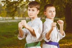 Boys in white kimono during training karate Royalty Free Stock Images
