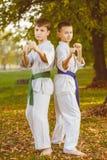 Boys in white kimono during training karate Royalty Free Stock Photo
