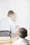 Boys at whiteboard Stock Image