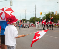 Boys woching a Canada Day parade. Canada. Stock Photography