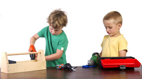 Boys working with their tools. With a white background Stock Photo