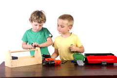 Boys working with their tools. With a white background Royalty Free Stock Photography