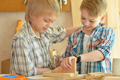 Boys  working with wood in  workshop Stock Photography