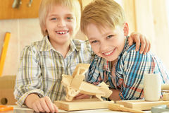 Boys  working with wood in  workshop Royalty Free Stock Photography