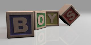 BOYS written with wooden blocks. Wooden blocks arranged in the word BOYS Stock Images