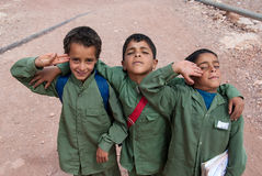 Boys in Yemen. Three unidentified boys, dressed in school uniforms, pose for the camera on May 5, 2007 in Thula, Yemen. Although infant mortality is high Stock Photo