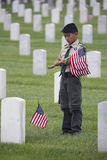 Boyscout places one of 85, 000 US Flags at 2014 Memorial Day Event, Los Angeles National Cemetery, California, USA Royalty Free Stock Photography