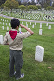 Boyscout salutes at one of 85, 000 US Flags at 2014 Memorial Day Event, Los Angeles National Cemetery, California, USA Royalty Free Stock Photography