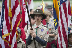 Boyscouts display US Flag at solemn 2014 Memorial Day Event, Los Angeles National Cemetery, California, USA royalty free stock images