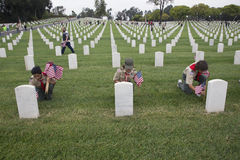 Boyscouts placing one of 85, 000 US Flags at 2014 Memorial Day Event, Los Angeles National Cemetery, California, USA Stock Photo