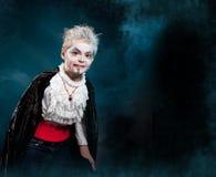 BOywearing as  a vampire for halloween. Boy wearing as vampire for halloween. Fog on the background Stock Photos