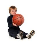 Boyy con Down Syndrome che gioca con la sfera Fotografia Stock Libera da Diritti