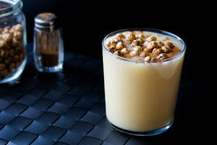 Boza or Bosa, traditional Turkish drink with roasted chickpea. With black backround Stock Images