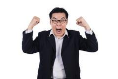 Boze Aziatische Chinese mens die kostuum dragen en beide vuist houden Royalty-vrije Stock Fotografie