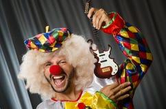 Boze clown met gitaar royalty-vrije stock afbeelding