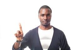Boze geklede toevallige Afro-Amerikaanse mens met witte t-shirt en het gesturing met vinger Stock Foto