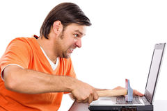 Boze jonge mens bij laptop Royalty-vrije Stock Foto's