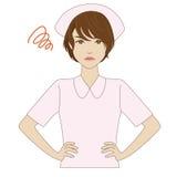Boze verpleegster in roze eenvormig Stock Afbeeldingen