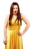 Boze vrouwenvrouw in het gele kleding gillen Royalty-vrije Stock Foto