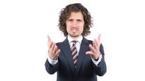 Boze zakenman die bij camera, Krullende Haren schreeuwen stock foto's