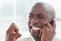 Boze zakenman op de telefoon Stock Foto