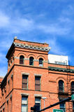Bozeman Hotel. The Bozeman Hotel in Bozeman, Montana is Romanesque Revival architecture.  Image shows corner of building and arched windows on main street of Royalty Free Stock Photos