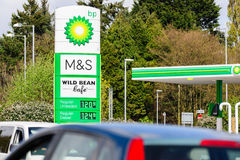 BP Petrol Station. BP Connect and Wild Bean cafe sign in a British filling station partnered with Marks and Spencer M&S Simply food offering convenience store Royalty Free Stock Image
