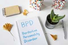 BPD Borderline Personality Disorder written in notebook. On white table royalty free stock image