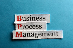 Bpm abbreviation. BPM business process management on blue paper Stock Photography