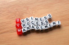 BPM  business process management. On  dices  on wooden  background Stock Photos