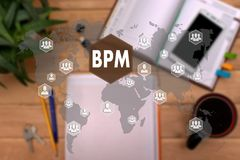 BPM. Business Process Management on the touch screen to the net. Work, on office background blur.Concept of Business Process Management stock photography