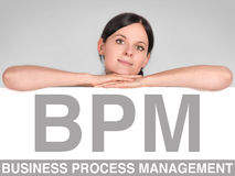 BPM icon. Woman leans on a board with a BPM icon Stock Photography