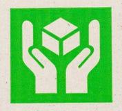 bräckligt symbol på papp. Arkivbilder