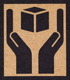 Bräckligt symbol på papp. Arkivbild