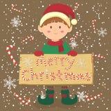 Brädegodis Cane Christmas Elf Boy Fotografering för Bildbyråer