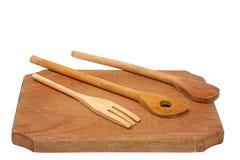 brädet som hugger av few, skedar trä Arkivbild