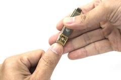Bräm eller urklipp en tumme på isolerad bakgrund Arkivfoton
