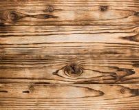 Brända träbräden med fnurentextur Arkivbild