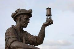 bränna till kol gruvarbetaren Arkivfoton
