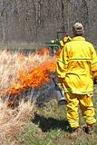 brännande kontrollerade guards Arkivfoto