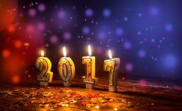 Brännande stearinljus numrerar 2017 och färgrika stänk med glitteri Royaltyfri Bild