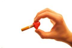 bränner cigaretthjärta Royaltyfria Bilder