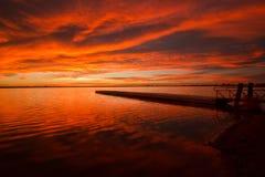 Brännhet himmel på fiskepir Royaltyfria Bilder