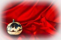 Brännhet-röd bakgrund för lyckönskan på jul och ny Ye Arkivbild
